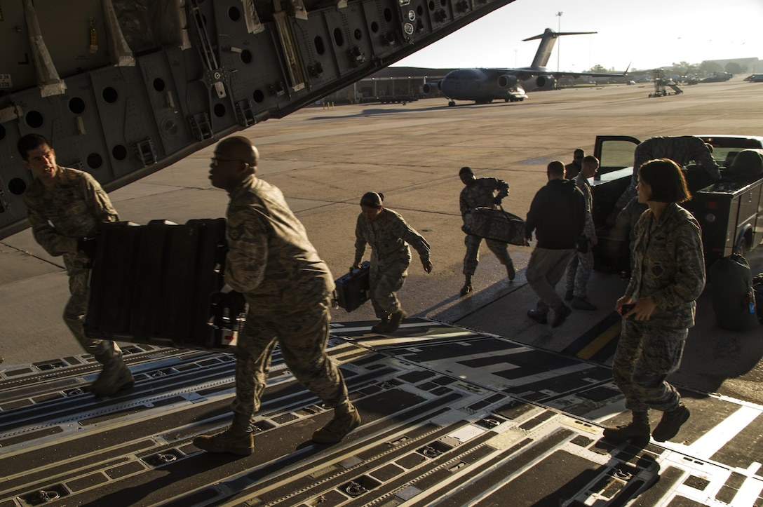 Members of the 621st Contingency Response Wing load equipment onto a C-17 Globemaster III at Joint Base McGuire-Dix-Lakehurst, N.J. before departing to support humanitarian relief efforts Port-au-Prince, Haiti, in response to Hurricane Matthew, October 6, 2016. Once on the ground, the CRW will provide assistance by facilitating the movement of humanitarian aid and cargo. (U.S. Air Force photo by Tech. Sgt. Gustavo Gonzalez/Released)