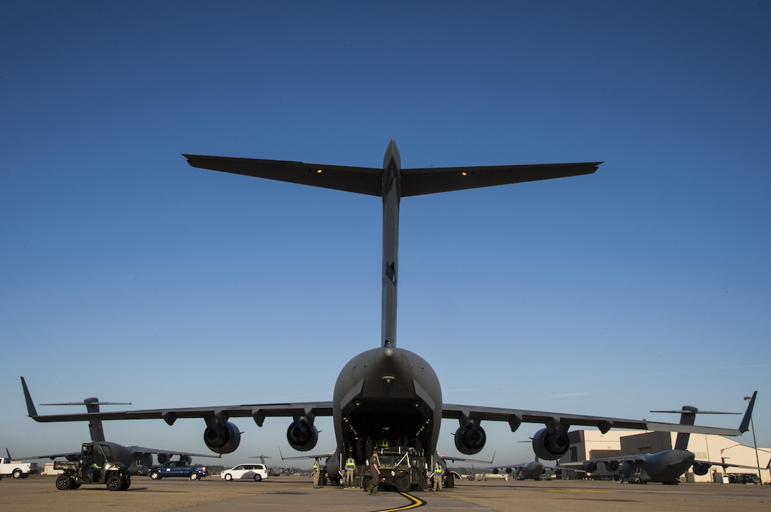Members of the 621st Contingency Response Wing load equipment onto a C-17 Globemaster III at Joint Base McGuire-Dix-Lakehurst, N.J. before departing to support humanitarian relief efforts at Port-au-Prince, Haiti, October 6, 2016. More than 30 members of the CRW deployed in response to Hurricane Matthew. (U.S. Air Force photo by Tech. Sgt. Gustavo Gonzalez/Released)