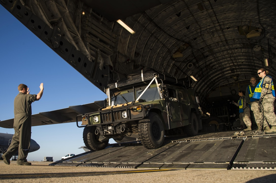 U.S. Air Force aerial porters assigned to the 305th Aerial Port Squadron load a Humvee onto a C-17 Globemaster III at Joint Base McGuire-Dix-Lakehurst, N.J., October 6, 2016. The Humvee, along with other equipment and more than 30 members of the 621st Contingency Response Wing will be on their way to Port-au-Prince, Haiti in response to Hurricane Matthew. The CRW is highly-specialized in rapidly deploying personnel to quickly open airfields and establish, expand, sustain, and coordinate air mobility operations alongside joint and intra-agency partners. (U.S. Air Force photo by Tech. Sgt. Gustavo Gonzalez/Released)