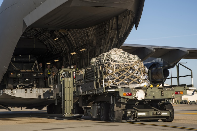 Equipment is loaded onto a C-17 Globemaster III at Joint Base McGuire-Dix-Lakehurst, N.J. for a 621st Contingency Response Wing deployment mission to Port-au-Prince, Haiti, October 6, 2016. More than 30 CRW members will meet up with U.S. Army Soldiers assigned to the 689th Rapid Port Opening Element and members of the Defense Logistics Agency at Joint Base Langley-Eustis, Va. (U.S. Air Force photo by Tech. Sgt. Gustavo Gonzalez)