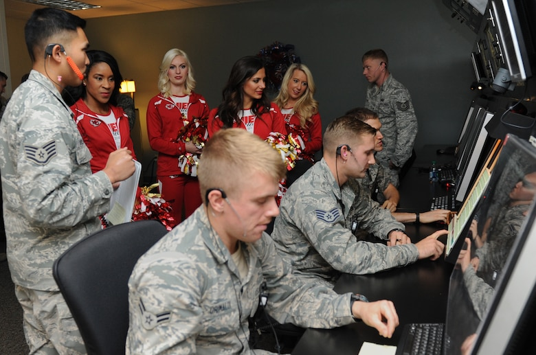 Staff Sgt. Michael Villamor, 334th Training Squadron instructor, briefs Kansas City Chiefs cheerleaders on the 334th TRS air traffic control tower radar course during a tour at Cody Hall Sept. 30, 2016, on Keesler Air Force Base, Miss. The NFL cheerleaders visited Keesler to learn about the mission, hold a cheer clinic at the youth center and participate in a fashion show at the base exchange. (U.S. Air Force photo by Kemberly Groue/Released)