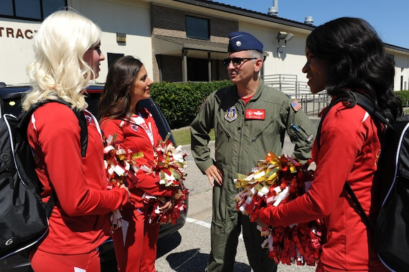 Lt. Col. Jeff Ragusa, 403rd Operations Support Squadron pilot, greets Kansas City Chiefs cheerleaders at the visitor's center Sept. 30, 2016, on Keesler Air Force Base, Miss. The NFL cheerleaders visited Keesler to learn about the mission, hold a cheer clinic at the youth center and participate in a fashion show at the base exchange. (U.S. Air Force photo by Kemberly Groue/Released)