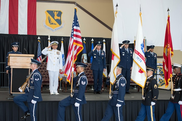 YOKOTA AIR BASE, Japan (Oct. 6, 2016) - Adm. Harry B. Harris, commander of U.S. Pacific Command, left, Gen. Terrence J. O'Shaughnessy, commander of Pacific Air Forces, Lt. Gen. Jerry Martinez renders honors during presentation of the Colors.  Martinez assumed the responsibilities as commander of USFJ and the 5th Air Force.