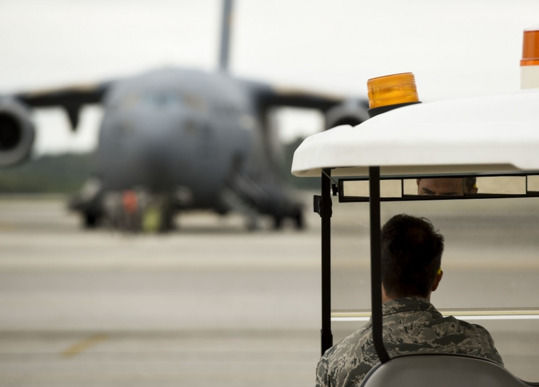 U.S. Air Force Master Sergeant Craig Carpenter, 437th Maintenance Group maintainer, inspects a Joint Base Charleston C-17 Globemaster III prior to it evacuating to Fort Campbell, KY on Oct. 6, 2016. Due to Hurricane Matthew, a Limited Evacuation Order of South Carolina Hurricane Evacuation Zones was issued by the Commander, Joint Base Charleston. All Joint Base personnel are expected to evacuate the area and will return once damage is assessed and it's safe to return.