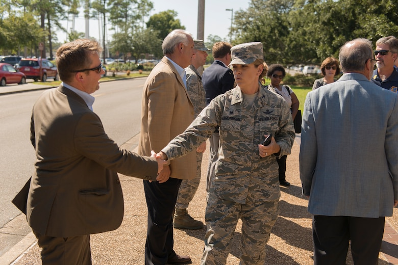Col. Michele Edmondson, 81st Training Wing commander, greets the 81st TRW honorary commanders outside the Keesler Medical Center Sept. 29, 2016, on Keesler Air Force Base, Miss. The honorary commanders, who are local civilian civic and business leaders, toured the physical therapy clinic, emergency room and intensive care unit to learn more about the capabilities and mission of the 81st MDG. (U.S. Air Force photo by Andre' Askew/Released)