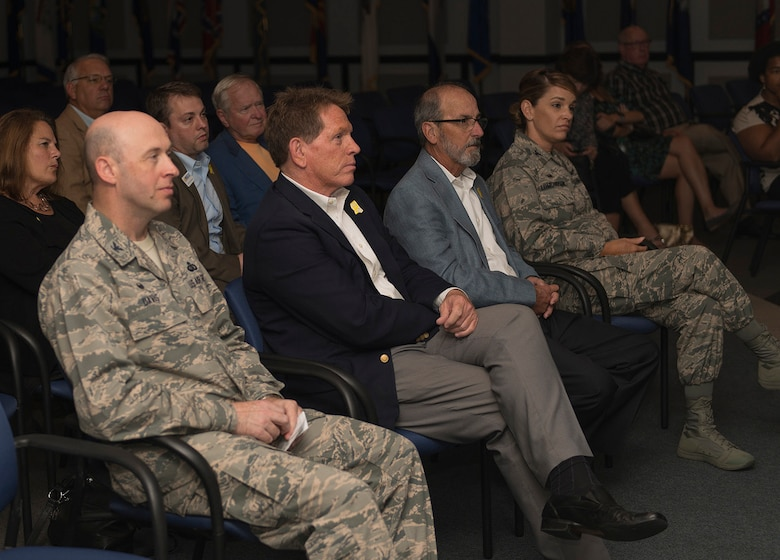 Honorary commanders and 81st Training Wing leadership listen to an 81st Medical Group mission brief at the Keesler Medical Center's Don Wylie Auditorium Sept. 29, 2016, on Keesler Air Force Base, Miss. The honorary commanders, who are local civilian civic and business leaders, toured the physical therapy clinic, emergency room and intensive care unit to learn more about the capabilities and mission of the 81st MDG. (U.S. Air Force photo by Andre' Askew/Released)