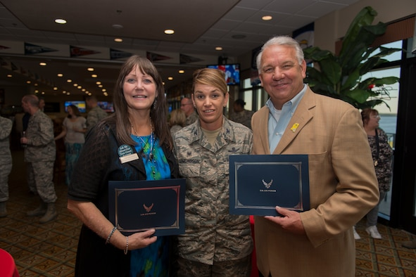 Col. Michele Edmondson, 81st Training Wing commander, presents Toni Ganucheau, The Peoples Bank branch manager, and Pastor Jeff Ulmer, New Life Family Church pastor, with certificates after inducting both as the newest 81st TRW honorary commanders at the Bay Breeze Event Center Sept. 29, 2016, on Keesler Air Force Base, Miss. The honorary commanders, who are local civilian civic and business leaders, toured the physical therapy clinic, emergency room and intensive care unit to learn more about the capabilities and mission of the 81st MDG. (U.S. Air Force photo by Andre' Askew/Released)