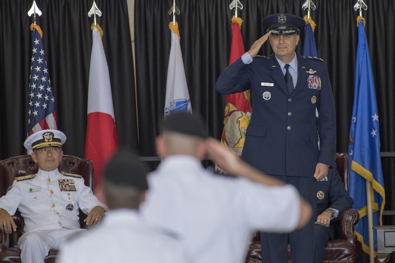 Lt. Gen. Jerry P. Martinez, United States Forces, Japan and 5th Air Force commander, returns his first salute from service members during the USFJ and 5th AF assumption of command ceremony at Yokota Air Base, Japan, Oct. 6, 2016. Martinez was the former director of operations, Headquarters Air Mobility Command, Scott Air Force Base, Ill. (U.S. Air Force photo by Yasuo Osakabe/Released)