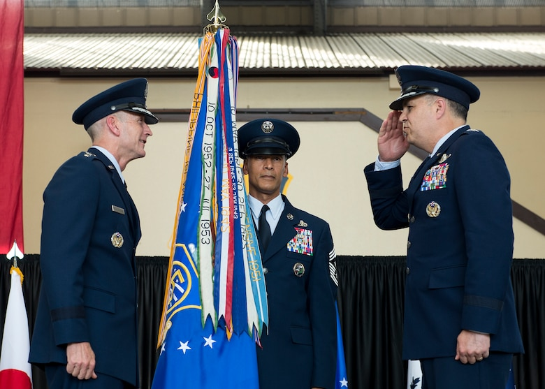 U.S. Air Force Lt. Gen. Jerry P. Martinez, incoming United States Forces, Japan and 5th Air Force commander, salutes Gen. Terrence J. O'Shaughnessy, Pacific Air Forces commander, before accepting the USAF and 5th Air Force guidon during his Assumption of Command ceremony October 6, 2016, at Yokota Air Base, Japan. Martinez was the former Headquarters Air Mobility Command director of operations at Scott Air Force Base, Ill. (U.S. Air Force photo by Airman 1st Class Donald Hudson/Released)