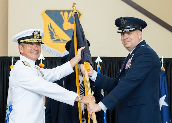 U.S. Air Force Lt. Gen. Jerry P. Martinez, incoming United States Forces, Japan and 5th Air Force commander, accepts the guidon from Adm. Harry B. Harris Jr., U.S. Pacific Command commander, during the Assumption of Command ceremony October 6, 2016, at Yokota Air Base, Japan. Harris and Gen. Terrence J. O'Shaughnessy, Pacific Air Forces commander, presided over the ceremony. (U.S. Air Force photo by Airman 1st Class Donald Hudson/Released)