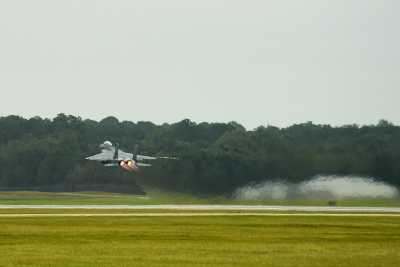 An F-15E Strike Eagle from the 335th Fighter Squadron takes off as a precautionary measure to avoid severe weather associated with Hurricane Matthew, Oct. 6, 2016, at Seymour Johnson Air Force Base, North Carolina. More than 40 F-15E Strike Eagles were repositioned to Barksdale Air Force Base, Louisiana. (U.S. Air Force photo by Airman Shawna L. Keyes)