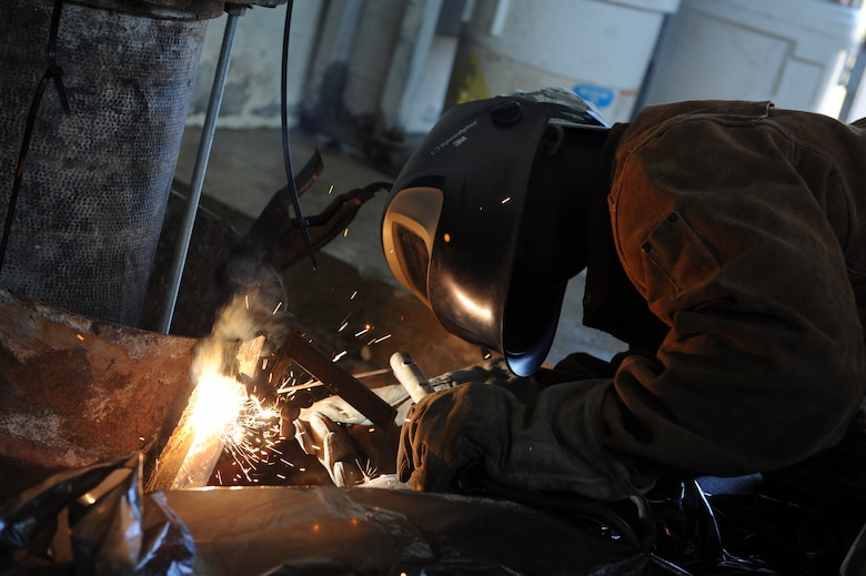 Senior Airman Gilbert Julien, 8th Civil Engineering Squadron Structures journeyman, secures a concrete through coupler at Kunsan Air Base, Republic of Korea, Oct. 6, 2016. 8th CES members are responsible for maintaining water treatment facilities throughout the base. These facilities provide airmen with potable water so they are continually able to Defend the Base, Accept Follow-On Forces and Take the Fight North. (U.S. Air Force photo by Senior Airman Michael Hunsaker/Released)