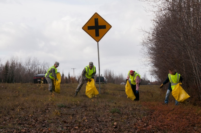 Master Sgt. Ella Doak, Senior Master Sgt. Shawn Morrissey, Senior Airman Casey Franich, and Master Sgt. Tina Rabjohns from the 168th Wing, Alaska Air National Guard, work together to pick up trash and debris along the northbound side of the Richardson Highway between Eielson AFB and Fairbanks, Alaska on September 29, 2016. The wing's Top III Council, and at least 12 other organizations that work on Eielson, are active in the Alaska Department of Transportation and Public Facilities Adopt-A-Highway program and are helping keep approximately 26 miles of the highway clean.