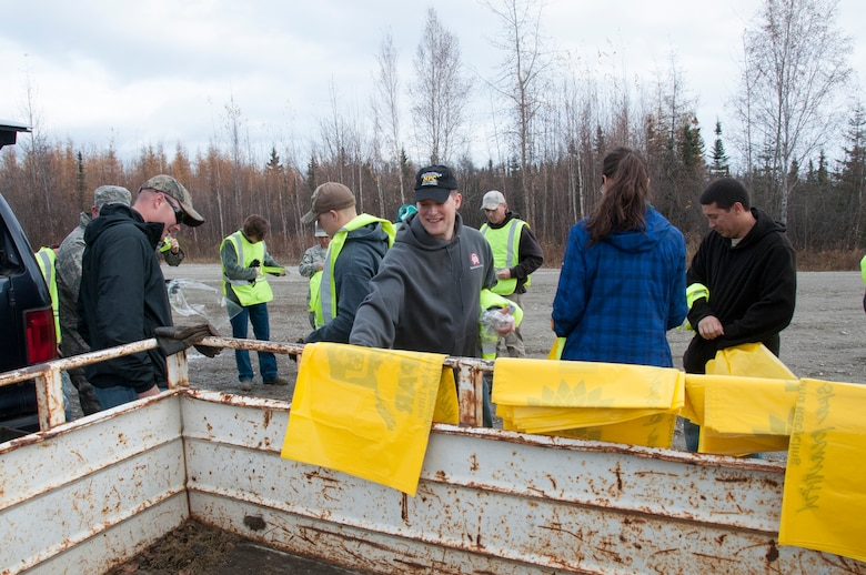 "Senior non-commissioned officers, or the ""Top III,"" from the 168th Wing, Alaska Air National Guard, family members, and other Airmen assigned to the unit at Eielson AFB, Alaska volunteered to pick up trash along the Richardson Highway between Eielson and Fairbanks, Alaska on September 29, 2016. The 168th's Top III, and at least 12 other organizations that work on Eielson, are active in the Alaska Department of Transportation and Public Facilities Adopt-A-Highway program and are helping keep approximately 26 miles of the highway clean."