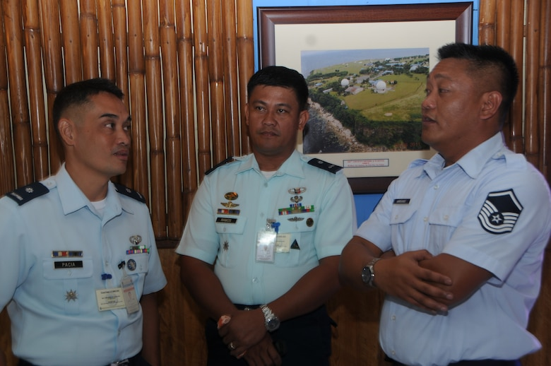 Philippine Air Force Maj. Frederick Pacia and PAF Maj. Nestor Ramos discuss radar maintanence with Master Sgt. Gino Marianno a radar maintanence technician assigned to the 169th Air Defense Squadron during a State Partnership Program subject matter expert change at Wallace Air Station, Aug. 29, 2016. The State Partnership Program is a National Guard program that links a state's national guard with a partner country to help build capacity and security cooperation. (U.S. Air National Guard photo by Senior Airman Orlando Corpuz/released)