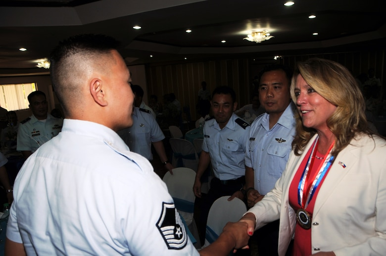 Master Sgt. Michael Cho assigned to the 169th Air Defense Squadron shakes hands with Secretary of the Air Force, Deborah Lee James during a lunch ceremony hosted by the Philippine Air Force at Basa Air Base, Philippines, Aug. 23, 2016. The coincedental meeting between Cho and James came as both were at Basa Air Base for seperate and unrelated engagements. Cho was participating in a State Partnership Program subject matter expert exchange with Philippine Air Force counterparts. The State Partnership Program is a National Guard program that links a state's national guard with a partner country to help build capacity and security cooperation. (U.S. Air National Guard photo by Senior Airman Orlando Corpuz/released)