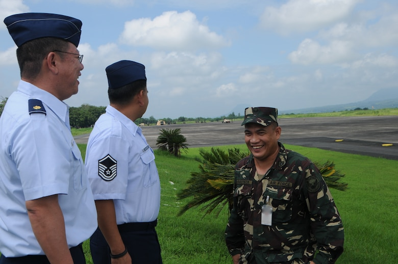 U.S. Air Force Maj. Colin Yoshimitsu, mission crew commander, 169th Air Defense Squadron and Master Sgt. Joseph Salvador, loadmaster, 204th Air Lift Squadron tour the airstrip at Basa Air Base, Philippines with Philippine Air Force Maj. Generoso Bautista during a State Partnership Program subject matter expert exhange Aug. 22, 2016. The State Partnership Program is a National Guard program that links a state's national guard with a partner country to help build capacity and security cooperation. (U.S. Air National Guard photo by Senior Airman Orlando Corpuz/released)