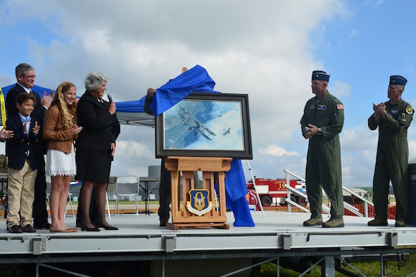 Susan Mozena speaks prior to the unveiling of a painting depicting former Reservist First Lieutenant Charles d'Olive, 93rd Pursuit Squadron, in the cockpit of his French-built Spad XIII pursuit aircraft engaging five German aircraft during World War I, Wright Field, Dayton Ohio, Oct. 1, 2016. The Mozena family were onstage during the unveiling. (U.S. Air Force Tech. Sgt. Pam Ives/Released)