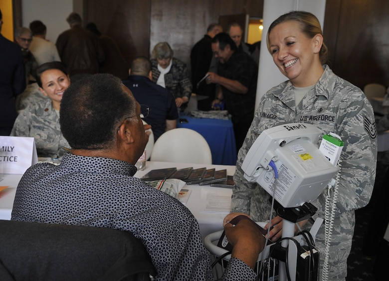 Medical personnel talk with a retiree during a Retiree Appreciation Week event at Ramstein Air Base, Germany, Oct. 4, 2016. The event provided a one-stop-shop for the retirees to take care of questions they may have about medical or legal matters as well as receive financial assistance and flu shots. (U.S. Air Force photo by Senior Airman Larissa Greatwood)