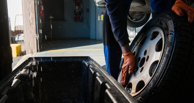 Retired Air Force Master Sgt. Greg Hermann, 86th Force Support Squadron Auto Hobby Shop tire technician, washes a vehicle's wheel at Ramstein Air Base, Germany, Oct. 5, 2016. To test for air leaks in a tire, Hermann washes the wheel with soap and water, and looks for pockets of air bubbles, an indicator that air is leaking out. (U.S. Air Force photo by Airman 1st Class Lane T. Plummer)