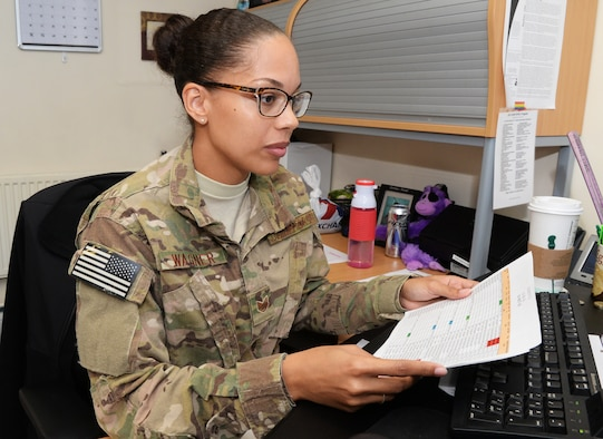 U.S. Air Force Staff Sgt. Lauren Wagner, 7th Special Operations Squadron NCO in charge of aviation resource management, works at her computer Oct. 6, 2016, on RAF Mildenhall, England. Wagner was submitted for the Square-D-Spotlight for being an outstanding member of Team Mildenhall. (U.S. Air Force photo by Airman 1st Class Tenley Long)