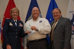 Defense Contract Management Agency Director Air Force Lt. Gen. Wendy Masiello and James Russell, deputy director, congratulate Keith Kalbfleisch at the agency's Worldwide Training Conference in June on receiving the 2016 Outstanding Personnel of the Year award for his work on developing an idea to automate Program Assessment Reports. Kalbfleisch, the engineering and manufacturing director at DCMA Lockheed Martin Orlando, and others from around the agency, provided input and lessons learned to create a faster and better way to provide the timely reports to customers. (DCMA photo by Tonya Johnson)