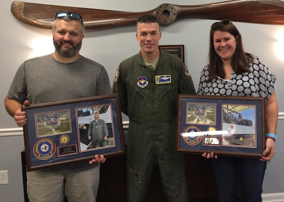 """Ty Mabry and Anne Hall Brashier, Military Legislative Aides for Sen. Thad Cochran of Mississippi, pause for a photo with Col. Doug Gosney, 14th Flying Training Wing Commander, after their T-6 Texan II orientation flights Oct. 6 at Columbus Air Force Base, Mississippi. The staffers, who were able to experience Air Force aviation for the first time, called it """"the highlight of the year."""" (U.S. Air Force photo by Richard Johnson)"""