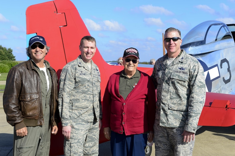 From the left, Peter Teichman, Hangar 11 Collection pilot, U.S. Air Force Col. Evan Pettus, 48th Fighter Wing commander, U.S. Air Force retired Lt. Col. George E. Hardy, Tuskegee Airman, and U.S. Air Force Col. David Eaglin, 48th FW vice commander, stand next to Hardy's former P-51D Mustang at Royal Air Force Lakenheath, England, Oct. 4, 2016. Hardy was the youngest Red Tail sent abroad during World War II and is one of the remaining 16 Tuskegee Airmen. (U.S. Air Force photo/ Senior Airman Malcolm Mayfield)