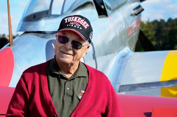 U.S. Air Force retired Lt. Col. George E. Hardy, a Tuskegee Airman, stands next to his former P-51D Mustang at Royal Air Force Lakenheath, England, Oct. 4, 2016. The Tuskegee Airmenwere an all African-American fighter group during World War II and consisted of more than 900 pilots who maintained and flew combat missions while overseas.  (U.S. Air Force photo/ Senior Airman Malcolm Mayfield)