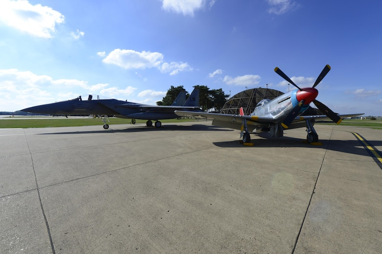 A World War II era P-51D Mustang sits next to a 493rd Fighter Squadron F-15C Eagle at Royal Air Force Lakenheath, England, Oct. 4. The Mustang was reunited with its former Tuskegee Airman pilot, U.S. Air Force retired Lt. Col. George E. Hardy. (U.S. Air Force photo/ Senior Airman Malcolm Mayfield)
