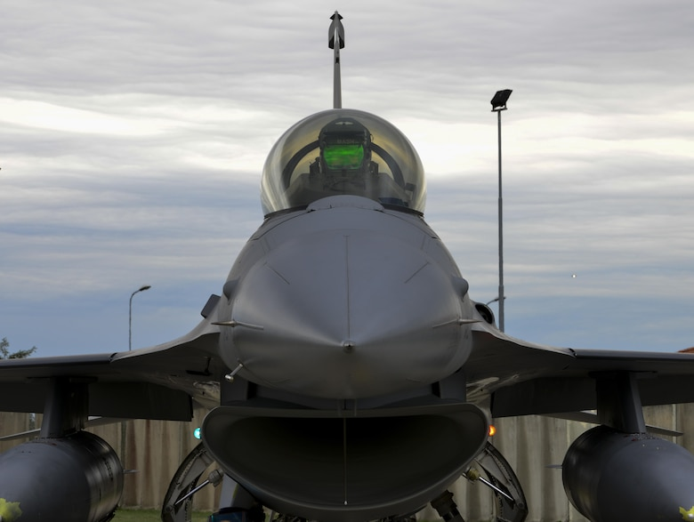 Capt. Nathan Skavdal, 555th Fighter Squadron F-16 Fighting Falcon pilot, sits inside of an F-16 at Aviano Air Base, Italy on Oct. 5, 2016. The 555th FS, also known as the Triple Nickel, has been assigned to Aviano since 1994. (U.S. Air Force photo by Senior Airman Krystal Ardrey/Released)