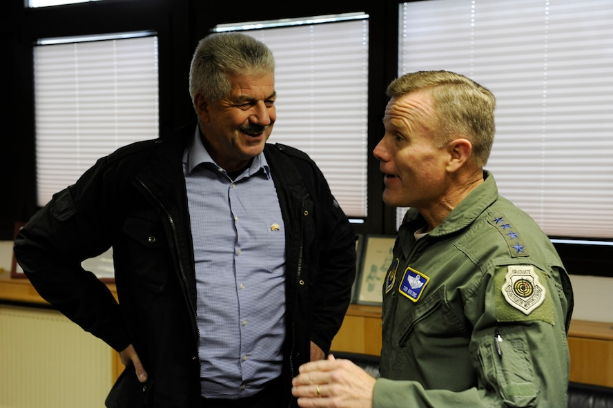 Gen. Tod D. Wolters, U.S. Air Forces in Europe and Air Forces Africa commander, right, visits with Klaus Rodens, Mayor of Spangdahlem, Germany, left, while touring Spangdahlem Air Base, Germany, Oct. 6, 2016. Wolters made his first visit to Spangdahlem since assuming command in August 2016. He spoke to Airmen on the importance their missions and highlighted his command priorities. (U.S. Air Force photo by Senior Airman Joshua R. M. Dewberry)