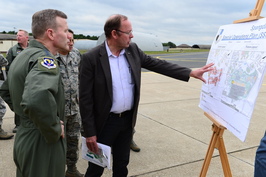 Gen. Tod D. Wolters, U.S. Air Forces in Europe and Air Forces Africa commander, left, receives a brief on constructional development while visiting Spangdahlem Air Base, Germany, Oct. 6, 2016. Wolters made his first visit to Spangdahlem since assuming command in August 2016, speaking to Airmen on the importance and uniqueness of their mission priorities. (U.S. Air Force photo by Senior Airman Joshua R. M. Dewberry)