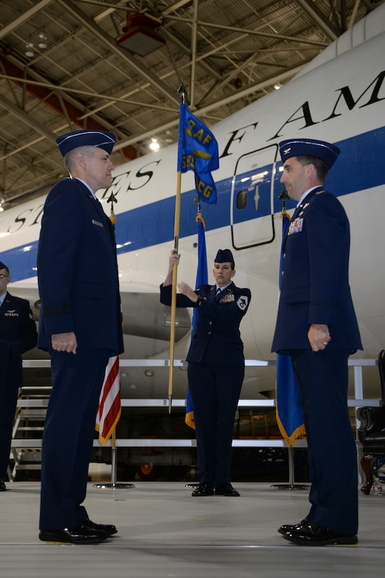 U.S. Col Robert Billings, right, prepares to accept the 595th Command and Control Group flag from Maj. Gen. Thomas Bussiere, Eighth Air Force commander, left, signifying his acceptance to command the group. The 595th CACG was activated during the E-4B realignment ceremony at Offutt Air Force Base, Neb., Oct. 7, as part of an initiative to house all Air Force nuclear assets under Air Force Global Strike Command. (U.S. Air Force photo by )