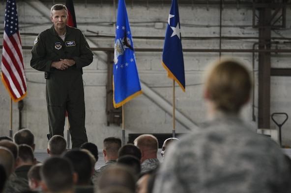 Gen. Tod D. Wolters, U.S. Air Forces in Europe and Air Forces Africa commander, listens to a question from Senior Airman Kimberly Deveau, 52nd Medical Operations Squadron medical technician, during a question and answer portion of an all call at Hangar One on Spangdahlem Air Base, Germany, Oct. 6, 2016. This visit represented his first time at Spangdahlem Air Base since assuming command in August 2016. (U.S. Air Force photo by Staff Sgt. Jonathan Snyder)