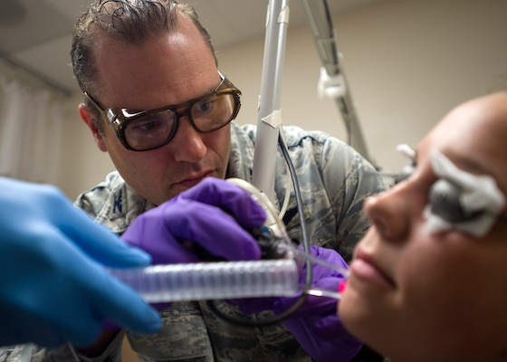 Col. (Dr.) Chad Hivnor, laser and research chief with the 59th Medical Specialty Squadron, uses a fractional carbon dioxide laser to treat a patient's scar at the Wilford Hall Ambulatory Surgical Center on Joint Base San Antonio-Lackland, Texas, Oct. 7. The laser treatment, also known as fractional skin resurfacing, goes deep into the epidermis of the skin and stimulates the production of collagen to create firm and smooth skin. Hivnor recently earned the San Antonio Business Journal 2016 Health Care Hero award for his contributions to health care in the local community. (U.S. Air Force photo/Staff Sgt. Kevin Iinuma)