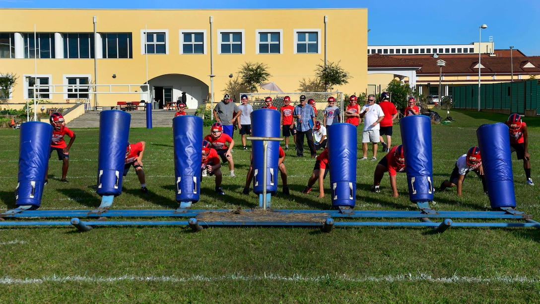 Aviano Saints football players perform practice drills at Aviano Air Base, Italy on Oct. 4, 2016. The coaches work to improve the player's football and life skills. (U.S. Air Force photo by Airman 1st Class Cary Smith/Released)