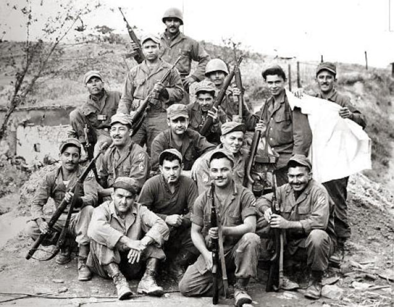 Members of the 65th Infantry Regiment pose for a photo after a firefight during the Korean War. The regiment consisted primarily of Puerto Rican soldiers who spoke mainly Spanish and prided themselves on having mustaches. By 1953, the regiment's soldiers had earned 14 Silver Stars, 23 Bronze Stars for valor and 67 Purple Hearts. Courtesy photo