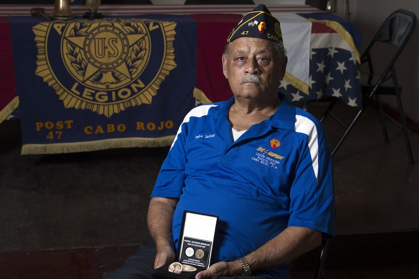 Korean War veteran Army Pfc. Pedro Jackson-Morales holds a Congressional Gold Medal in Cabo Rojo, Puerto Rico, Aug. 10, 2016. DoD photo by EJ Hersom