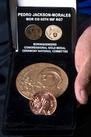 Korean War veteran Army Pfc. Pedro Jackson Morales holds a Congressional Gold Medal in Cabo Rojo, Puerto Rico, Aug. 10, 2016. DoD photo by EJ Hersom