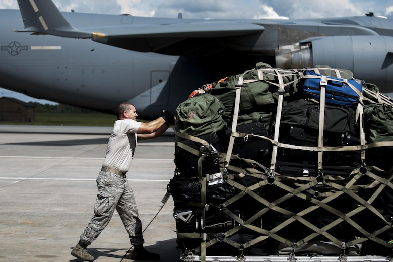 Staff Sgt. Brennon Scott, a 23rd Logistics Readiness Squadron air terminal operations supervisor, secures luggage and weapons on a pallet for a deployment Sept. 26, 2016, at Moody Air Force Base, Ga. The pallet was loaded onto a C-17 Globemaster III for transport. (U.S. Air Force photo/Airman 1st Class Daniel Snider)
