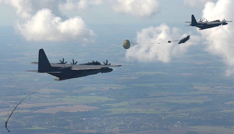 Two U.S. Air Force MC-130J Commando IIs perform Maritime Craft Aerial Delivery System drops over the Little Belt strait in Denmark Sept. 27, 2016. After rigid inflatable boats were deployed, U.S. Navy Special Warfare Combatant Craft crewmen followed to set up the equipment. Finally, a third aircraft off-loaded U.S. Air Force and Danish airmen at the drop zone. (U.S. Air Force photo/Senior Airman Justine Rho)
