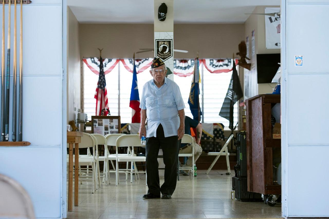 World War II veteran Army Sgt. 1st Class Santiago Pabon walks inside the American Legion in Cabo Rojo, Puerto Rico, Aug. 10, 2016. DoD photo by EJ Hersom