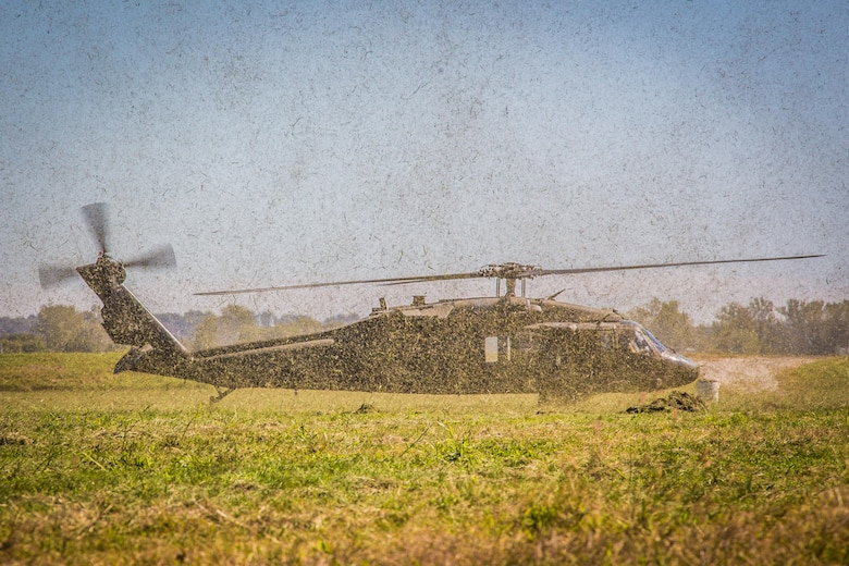 An Army UH-60 Black Hawk lands at a drop zone to extract Airmen assigned to Missouri Air National Guard's 180th Airlift Squadron during survival, evasion, resistance and escape training at Rosecrans Air National Guard Base, Mo., Sept. 29, 2016. SERE training is required for all aircrew to equip them with survival techniques in the event of an emergency. (U.S. Air Force photo/Senior Airman Patrick P. Evenson)