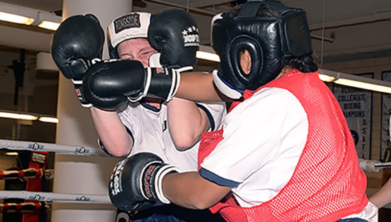 Two female cadets spar in a boxing ring Oct. 6, 2016, at the U.S. Air Force Academy. Previously, women took the Academy's mandatory Combatives I and II courses, but only male cadets were required to put on boxing gloves. The change follows Defense Department guidelines published in January opening combat roles to women. (U.S. Air Force photo/Darcie Ibidapo)