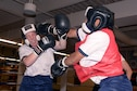 Two female cadets spar in a boxing ring Oct. 6, 2016, at the U.S. Air Force Academy. Boxing at the Academy opened this year for female cadets to correspond with Defense Department guidelines published in January 2016 that opened combat positions to women in the military. (U.S. Air Force photo/Darcie Ibidapo)
