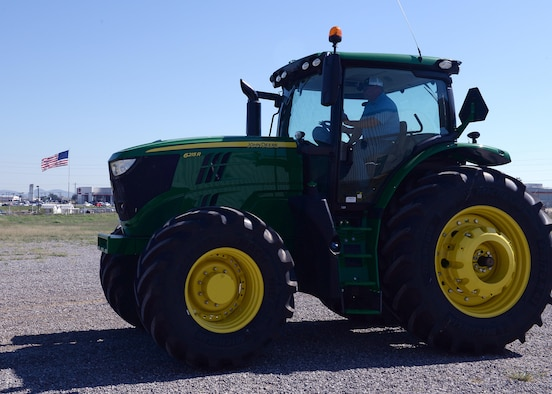 Participants of the Altus Chamber of Commerce Farm City Tour get the chance to drive a tractor, Oct. 3, 2016, at Great Plains Stampede Rodeo Grounds, Altus, Okla. The tour was part of 39th annual Farm City Week, which brings the business, military and farming communities closer together by highlighting the farming community of Altus. (U.S. Air Force photos by Airman First Class Cody Dowell/Released)