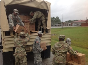 South Carolina National Guard Soldiers with the 1053rd Transportation Company deliver meals ready to eat to the emergency shelter at Westview Middle School, Goose Creek, S.C., Oct. 7, 2016, in advance of Hurricane Matthew. Multiple shelters have been established in the low country to assist citizens affected by the storm.