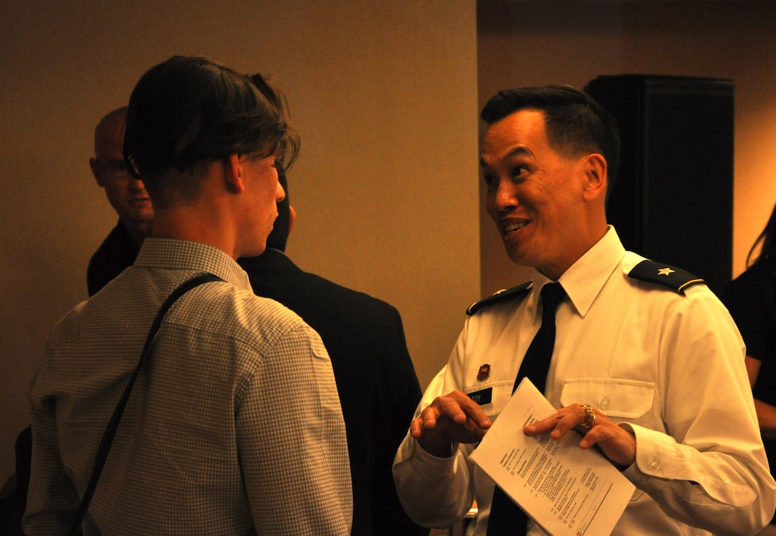 """Brig. Gen. Mark Toy talks with a student during the Corps' job opportunity seminar held at HENAAC in Anaheim, California. """"Find your passion,"""" Toy said."""