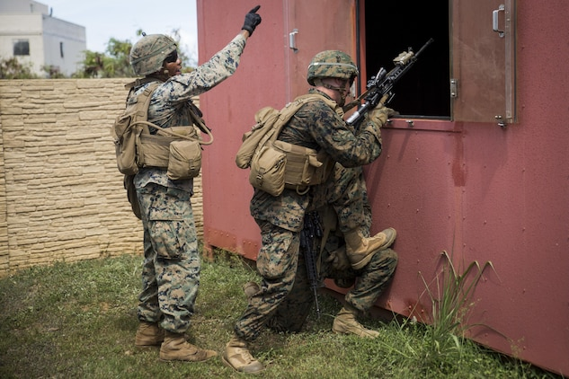 MARINE CORPS BASE HAWAII – Marines from Alpha Company, 1st Battalion, 3rd Marine Regiment, practice clearing buildings during Exercise Island Viper aboard Marine Corps Base Hawaii, Sept. 27, 2016. Marines wrap up their final week of Exercise Island Viper, an annual pre-deployment training event preparing Marines for a larger exercise in the Pacific Region. During Exercise Island Viper, the Marines practiced clearing buildings, patrolling through simulated villages, solved obstacles at the Leadership Reaction Course and traversing through an Improvising Explosive Devices course. (U.S. Marine Corps Photo by Lance Cpl. Jesus Sepulveda Torres)